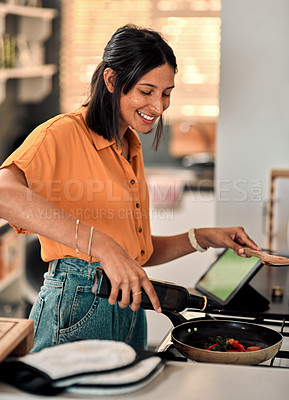 Buy stock photo Shot of a happy young woman preparing a healthy meal at home