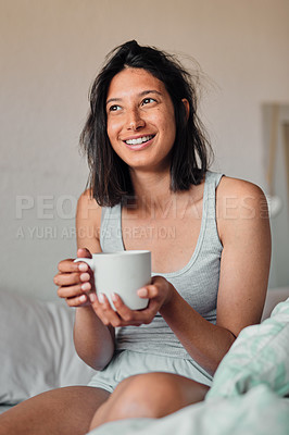 Buy stock photo Shot of a young woman enjoying a relaxing cup of coffee in bed at home