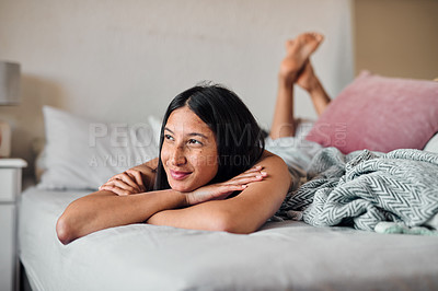 Buy stock photo Shot of a young woman enjoying a relaxing moment in bed at home