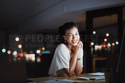 Buy stock photo Cropped portrait of an attractive young businesswoman working late at night in her office