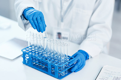 Buy stock photo Closeup shot of an unrecognisable scientist working with samples in a lab