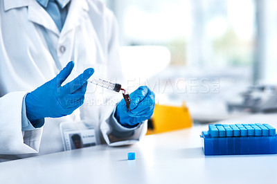 Buy stock photo Closeup shot of an unrecognisable scientist using a syringe while working in a lab