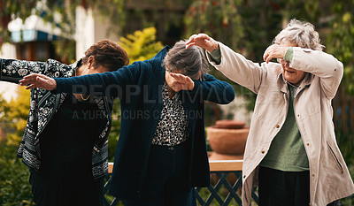 Buy stock photo Cropped shot of a group of senior woman standing together and dabbing during a tea party outdoors
