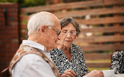 Buy stock photo Cropped shot of two senior friends sitting together and enjoying a tea party while outdoors