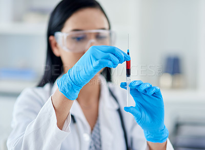 Buy stock photo Shot of a young scientist conducting an experiment in a laboratory