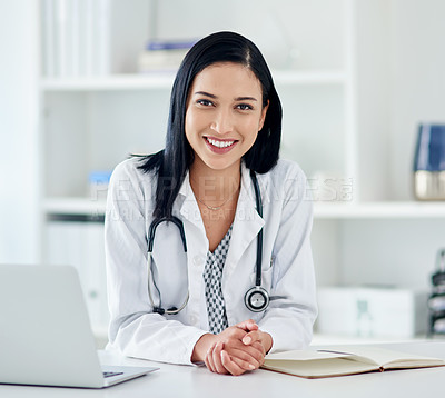 Buy stock photo Portrait of a young doctor working at her desk