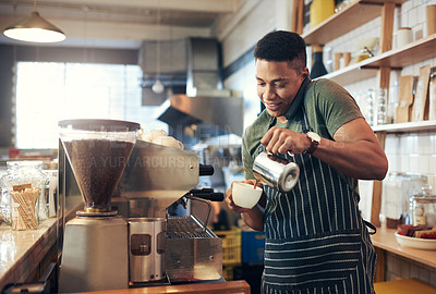 Buy stock photo Shot of a young man talking on a phone while preparing a cup of coffee in a cafe