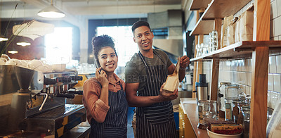 Buy stock photo Shot of a young man and woman working together in a cafe
