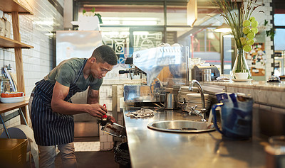 Buy stock photo Shot of a young man cleaning in a cafe