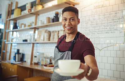 Buy stock photo Portrait of a young waiter holding a cup of coffee in a cafe