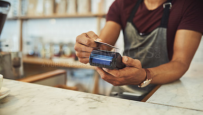 Buy stock photo Closeup shot of an unrecognisable waiter processing a credit card payment in a cafe