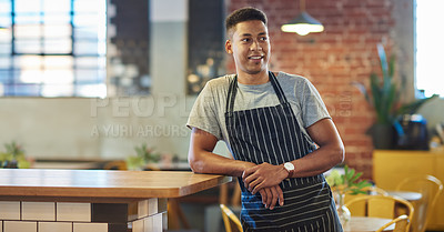 Buy stock photo Shot of a young man working in a cafe
