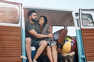 Buy stock photo Shot of a happy young couple enjoying a road trip together