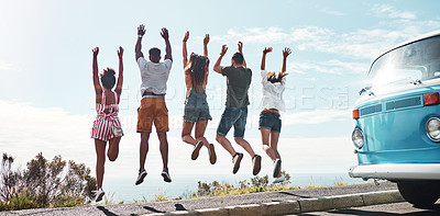 Buy stock photo Rearview shot of a group of friends looking cheerful while out on a road trip