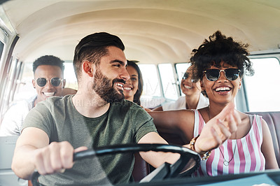 Buy stock photo Cropped shot of a group of friends out on a road trip together