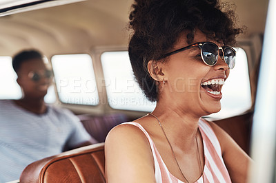 Buy stock photo Cropped shot of a beautiful young woman enjoying herself while out on a road trip