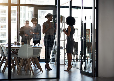 Buy stock photo Full length shot of a diverse group of businesspeople having discussions in a boardroom