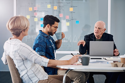 Buy stock photo Cropped shot of a group of diverse businesspeople having a meeting in a modern office