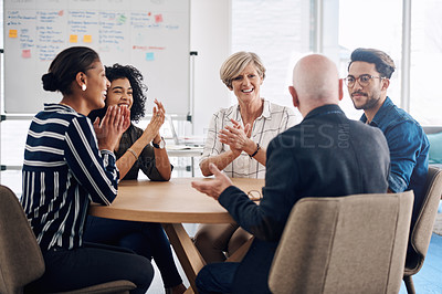 Buy stock photo Cropped shot of a group of diverse businesspeople applauding a colleague during a meeting in a modern office