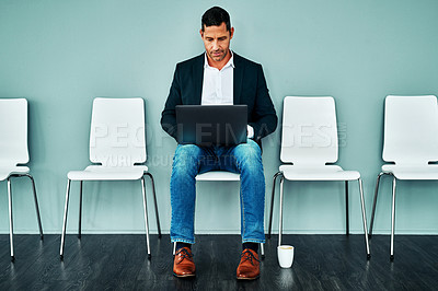 Buy stock photo Studio shot of a mature businessman using a laptop while waiting in line against a blue background