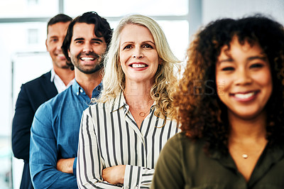 Buy stock photo Portrait of a group of diverse businesspeople standing in line in a modern office