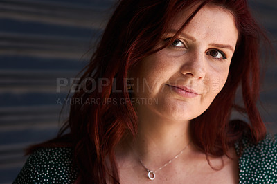 Buy stock photo Cropped shot of a beautiful young woman standing outside against a grey background