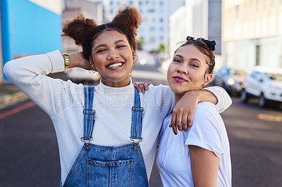 Buy stock photo Cropped shot of two young woman out in the city during the day