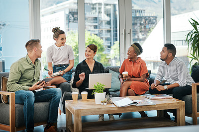 Buy stock photo Cropped shot of a diverse group of businesspeople sitting in the office together and having a meeting