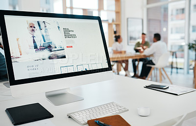 Buy stock photo Cropped shot of a website page displayed on an office computer while businesspeople work in the background