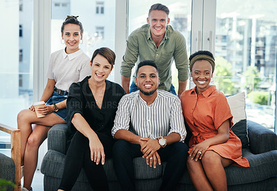 Buy stock photo Cropped portrait of a diverse group of business colleagues sitting together in the office