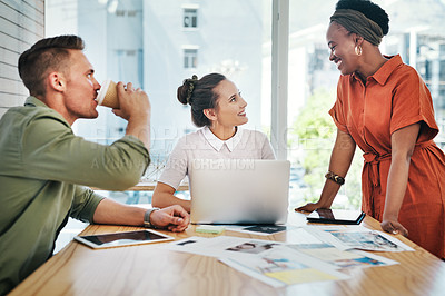 Buy stock photo Cropped shot of a diverse group of business colleagues having a discussion in the office