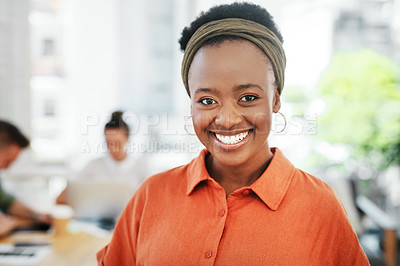Buy stock photo Cropped portrait of an attractive young businesswoman standing alone in the office and smiling at the camera
