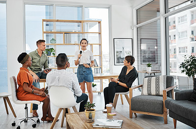 Buy stock photo Full length shot of a diverse group of businesspeople sitting in the office together and having a meeting