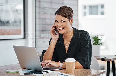 Buy stock photo Cropped portrait of an attractive young businesswoman sitting alone and talking on her cellphone in the office