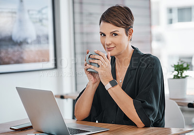 Buy stock photo Cropped portrait of an attractive young businesswoman sitting alone and enjoying a cup of coffee in her office