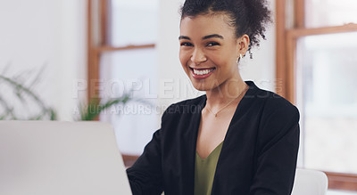 Buy stock photo Cropped portrait of an attractive young businesswoman smiling while using a laptop in her office during the day