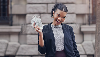 Buy stock photo Cropped portrait of an attractive young businesswoman smiling while holding a stack of money while standing outdoors in the city