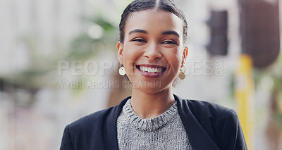 Buy stock photo Cropped portrait of an attractive young businesswoman smiling while standing outdoors in the city