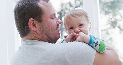 Buy stock photo Cropped shot of an affectionate young father carrying his baby girl at home