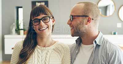 Buy stock photo Cropped shot of an affectionate young woman smiling while spending time with her husband indoors at home