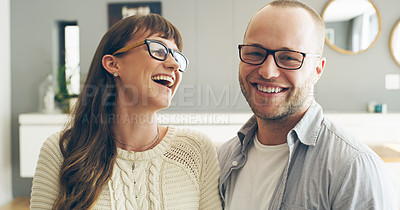 Buy stock photo Cropped shot of an affectionate young man smiling while spending time with his wife indoors at home