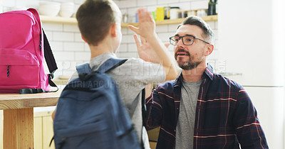 Buy stock photo Shot of a father giving his son a high five before leaving for school