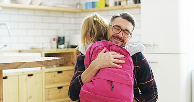Buy stock photo Shot of a father hugging his daughter before she leaves for school