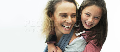 Buy stock photo Shot of a mother giving her daughter a piggyback ride outdoors