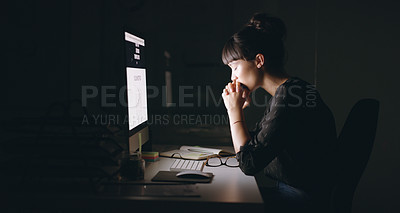 Buy stock photo Shot of a young businesswoman sitting with her hands clasped while working on a computer in an office at night