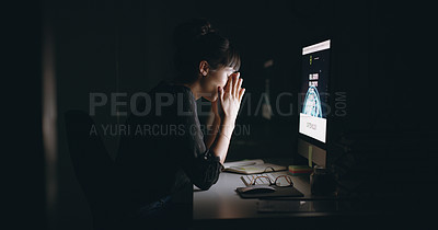 Buy stock photo Shot of a young businesswoman looking stressed out while working on a computer in an office at night