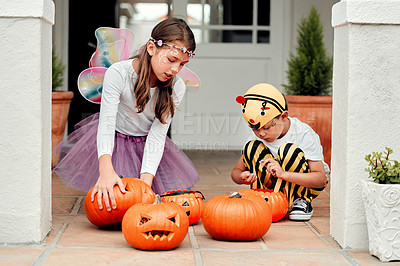 Buy stock photo Shot of two adorable young siblings playing together on Halloween at home