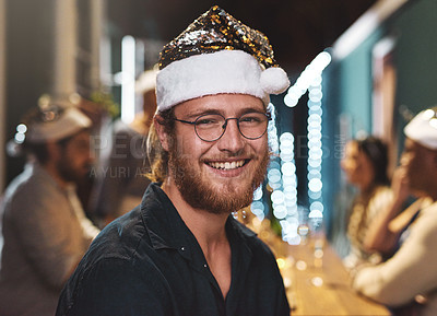 Buy stock photo Portrait of a cheerful young man wearing a festive hat at home during christmas time