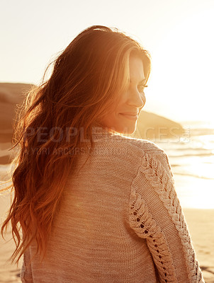 Buy stock photo Portrait of a young woman spending some time at the beach