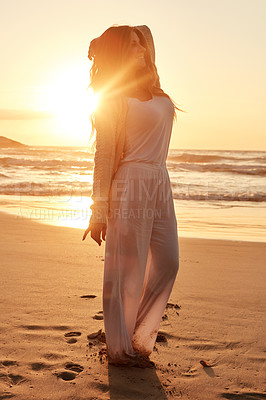 Buy stock photo Shot of a young woman spending some time at the beach
